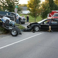 Police respond at the scene of a two-vehicle collision in Monticello on Sunday.