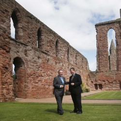 Scotland's First Minister Alex Salmond (L) speaks with Historic Scotland employee Douglas Wilson during a visit to Arbroath Abbey, in Arbroath, Scotland August 18, 2014.