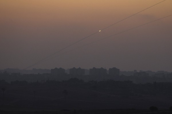 A rocket is seen as it is fired from the northern Gaza Strip towards Israel August 24, 2014. Israeli Prime Minister Benjamin Netanyahu warned Palestinian civilians on Sunday to leave immediately any site where militants are operating, one day after Israel took the Gaza war to a new level by flattening a 13-story apartment tower.