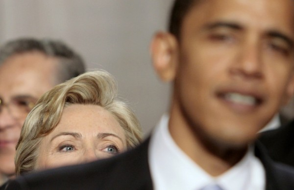 Then Sen. Barack Obama (right) stands in front of former Sen. Hillary Clinton as they arrive at the U.S. Capitol in Washington in this January 2007 file photo.