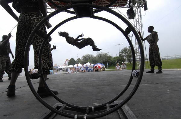 The Mapapa African Acrobats from Kenya perform in the vendor area of the Bangor State Fair during its opening day.