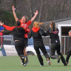 Scarborough High School's Sarah Martens celebrates with teammates after she scored winning goal against Bangor High School in the Class A Championship game in Hampden in November 2012.