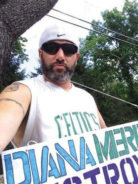 Jon Dixon, deli manager for Market Basket in Nashua, N.H., protested outside of Diana Merriam's Shore Road home this past weekend.