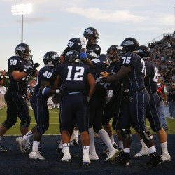 The University of Maine football team celebrates after scoring a touchdown in the first half against Norfolk State during their game Saturday at Morse Field in Orono.
