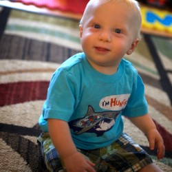 Carter Bilodeau, 11 months, smiles from the floor in his house in Gray on Friday. Bilodeau has been getting more rest after his parents met with child sleep consultant Jessica Begley.