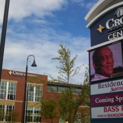 The Cross Insurance Center switched on its new sign for the first time Friday morning. Members of the Cross family, which donated the sign, joined city and arena officials Friday morning for a ceremony to commemorate the new promotional sign.