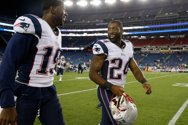 New England Patriots cornerback Darrelle Revis (24) heads off the field with wide receiver Brandon LaFell (19) after their preseason game Friday night at Gillette Stadium in Foxborough, Massachusetts. The Patriots defeated the Philadelphia Eagles 42-35.
