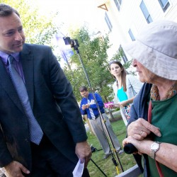 Maine House Speaker Mark Eves. D-North Berwick, speaks with Eunice St. John, 76, in Brunswick on Wednesday before announcing a series of proposals designed to build more affordable housing for seniors and otherwise help them remain in their homes as they age.