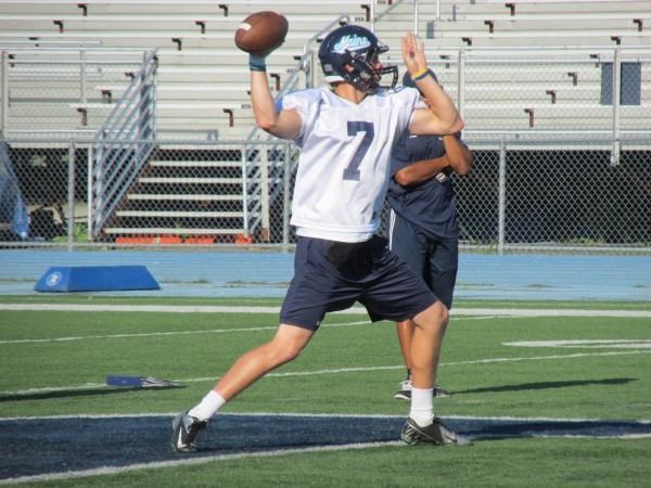 UMaine quarterback Dan Collins looks for an open receiver during a recent practice in Orono.