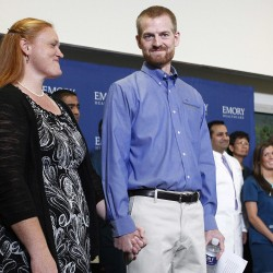 Kevin Brantly, (right) who contracted the deadly Ebola virus, stands with his wife, Amber, during a Thursday press conference at Emory University Hospital in Atlanta, Georgia.
