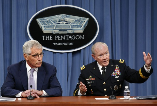 U.S. Secretary of Defense Chuck Hagel (left) and Chairman of the Joint Chiefs of Staff Gen. Martin Dempsey hold a press briefing on Aug. 21 at the Pentagon in Washington.