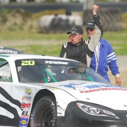 Joey Pastore celebrates after taking first place in the Sportsman class Sunday at Speedway 95 in Hermon. BDN Photo by Terry Farren