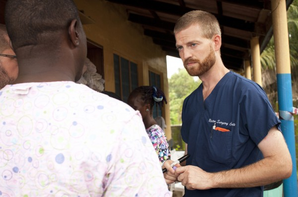 Dr. Kent Brantly (right) speaks with colleagues at the case management center on the campus of ELWA Hospital in Monrovia, Liberia, in this undated handout photograph courtesy of Samaritan's Purse.