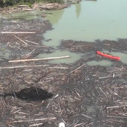 The breach of the large pond holding waste matter from the mine spilled some 10 million cubic meters of water and 4.5 million cubic meters of fine sand into Polley Lake in central British Columbia.