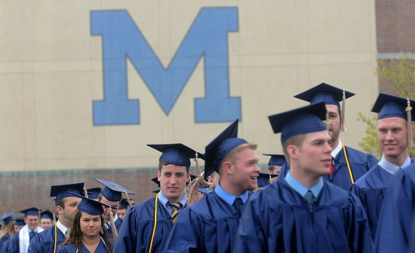 University of Maine students march from the Memorial Gym Field House to Alfond Arena, site of their commencement, at the University of Maine in Orono.