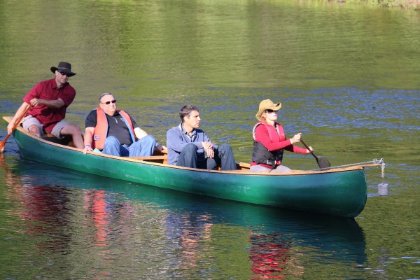 Gov. Paul LePage arrives by canoe to the opening ceremonies of the 2014 World Acadian Congress on Friday morning on the shores of Beau Lake in Quebec.