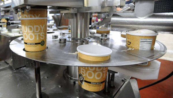 Quart-sized containers are filled by the machine at the Skowhegan-based Gifford's Famous Ice Cream company.