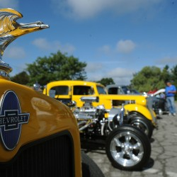 People look at the vehicles displayed during the Brewer Days car show in 2009.