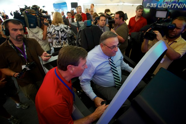 Gov. Paul LePage flies an F-35 Lightning II simulator at a Pratt & Whitney employee appreciation event in North Berwick Friday morning. The Pratt a& Whitney facility manufactures the F-35's engine. LePage joked he would like to find the Press Herald building and &quotblow it up.&quot