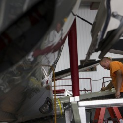 C&L Aerospace employee Brian Hart works last month.