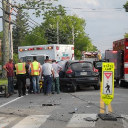Emergency personnel work Wednesday afternoon to cut a driver out of her car after a two-car crash in front of Waldo County General Hospital on Northport Avenue in Belfast.