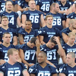University of Maine football players get ready for the team picture during media day on Friday at the University of Maine in Orono.