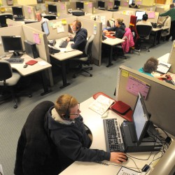 Employees receive orders at L.L. Bean's Bangor call center in 2012.