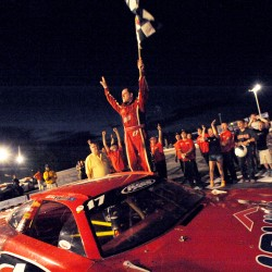 Travis Benjamin celebrates on top of his Super Late Model car after winning the Oxford 250 on July 20. The race is moving to Aug. 30 next year.