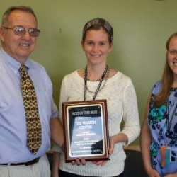 Ed Morin of Market Surveys of America presents an award for Best Hearing Aid Center in the Bangor Area to Warren Center Audiologists Nicole Duncan, AuD, CCC-A and Lisa Mages-Haskins, AuD, CCC-A