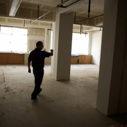 Mike Myatt of Bangor Housing shows an area of the Freese's building on Friday that will become a new juice bar in downtown Bangor.