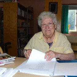 Faye Hafford looks over some printed copies of the scores of poems she's penned over the years.