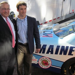 Gov. Paul LePage and NASCAR driver Austin Theriault pose for pictures in front of a Maine-branded car that Theriault will drive in a race on Sept. 20. LePage contributed about $15,000 from his contingency account to help pay for the car's decorative wrap.