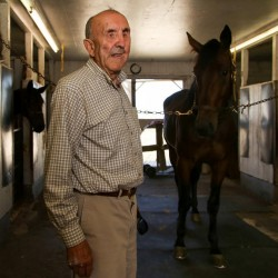 Yarmouth resident Don Richards, 81, at the Cumberland Fairgrounds with his horse, The Fighter. Richards, a 65-year veteran of harness racing, was severely injured in January while breaking a colt. He will be honored Sunday, Sept. 21, on opening day of the annual Cumberland County Fair.
