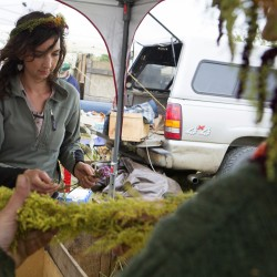 Ashley Winter (left) and Trisha Smith make flower crowns during the Common Ground Country Fair in Unity on Saturday.
