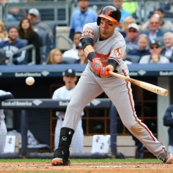 Baltimore Orioles third baseman Ryan Flaherty (3) singles to left center during the eighth inning against the New York Yankees at Yankee Stadium on Sept. 24, 2014. Baltimore Orioles won 9-5.