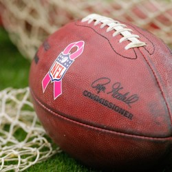 Detail view of a NFL football with the breast cancer awareness logo on the sidelines during a game in this November 2012 file photo.