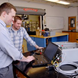 Students at Maine Maritime Academy in Castine enrolled in the marine systems engineering program work with a computer and small engine earlier this year. The school was ranked eighth among regional colleges in the north by U.S. News & World Report.