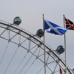 A Scottish Saltire flag and British Union flag fly together with the London Eye behind in London in this September 2014 file photo.