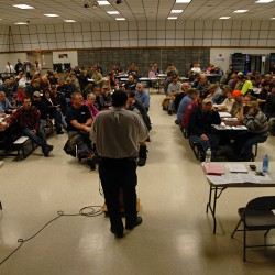More than 200 workers at Lincoln Paper and Tissue LLC listen as state Department of Labor and union officials brief them on unemployment benefits during a meeting at Mattamawcook Academy of Lincoln on Dec. 19, 2013.
