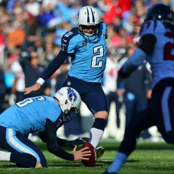 Tennessee Titans kicker Rob Bironas (center) kicks a field goal while punter Brent Kerns (left) holds the ball against the Houston Texans during the second half at LP Field in this December 2013 file photo.