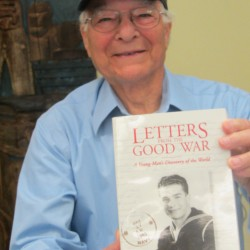 World War II veteran Hugh Aaron shows off his book of war letters published in 1997.