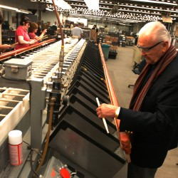 VicFirth inspects a drumstick as it comes out of a sorting machine at his Newport drumstick-making factory in this October 2008 file photo.
