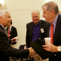Maine gubernatorial candidates Mike Michaud (left) and Eliot Cutler shake hands at an Environmental and Energy Technology Council of Maine forum at Hannaford Hall in Portland on Friday, Sept. 12. Gov. Paul LePage did not attend.