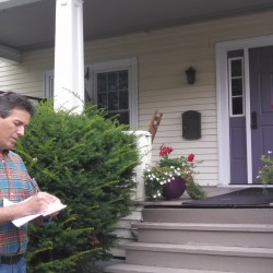 Wayne Pacelle, CEO of the Humane Society of the United States, looks over a list of registered voters while Jennifer Skiff knocks on a Bangor resident's door.