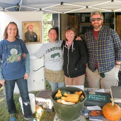 Val Derosier (second from left) of Long Shadow Farm in Morrill was surrounded Friday by volunteers who came to help run her booth at the Common Ground Fair. Derosier's life and farm partner, Mark Thompson, died unexpectedly just a week before the busy, important fair weekend and the community joined together to make sure she had plenty of help.