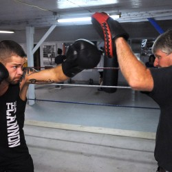 "Professional boxer Brandon Berry of West Forks (left) works out with his trainer Ken ""Skeet"" Wyman in July at Wyman's Boxing Club in Stockton Springs."