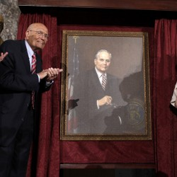 House Democratic Leader Nancy Pelosi, D-California, (L), Representative John Dingell, D-Michigan, and his wife, Deborah Dingell, unveil Dingell's portrait as the longest serving member of Congress during an event on Capitol Hill in Washington D.C., June 13, 2013. On June 7, Dingell reached 57 years, five months and 26 days of congressional service, passing the mark held by the late Senator Robert Byrd, D-West Virginia.