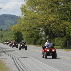ATVs rumble along Pritham Avenue in Greenville in this  May 26, 2012 photo.