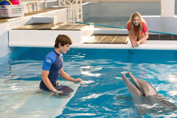 Nathan Gamble (left) as Sawyer Nelson and Cozi Zuehlsdorff as Hazel Haskett with Winter as herself in Alcon Entertainment's family adventure &quotDOLPHIN TALE 2&quot