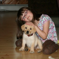"Meghan Ireland, 7, and her dog Tanner, who ""rehabilitated"" Meghan from her fear of canines."